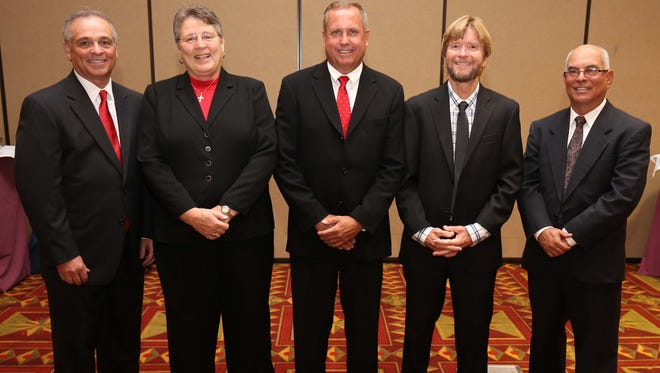 From the left, Mark Fisher, Cindy Henderson Snead, Brian Reynolds, Jim Klousia, and Keith Guttin were all recognized as new members of the Springfield Sports Hall of Fame on Tuesday evening at University Plaza Convention Center..