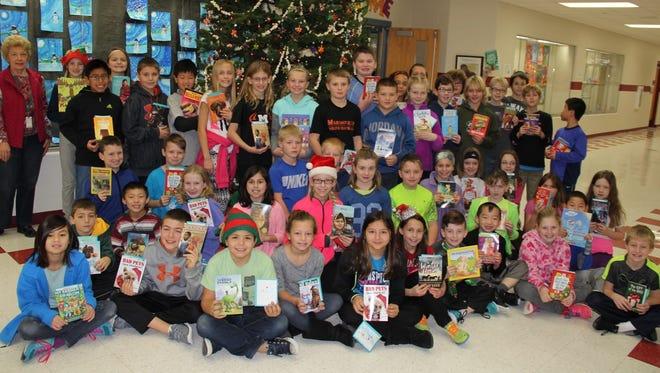 Joyce Fox, far left back row, poses with the fourth grade students at Washington Elementary School.