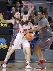 Ursuline's Maggie Connolly was often double teamed, like here as Conrad's Julie Kulesza (left) and Ja'Nylah Whittlesey apply the pressure in the Red Wolves' 40-37 victory in the semifinals of the DIAA Girls Basketball Tournament on March 9.