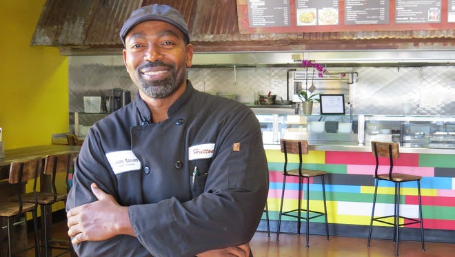 """Hutton John is co-owner of Caribbean Haven, a new restaurant in Ventura that focuses on dishes from Caribbean and Filipino cultures. """"This is the second half of my life,"""" says John, whose previous career was as a seed scientist."""