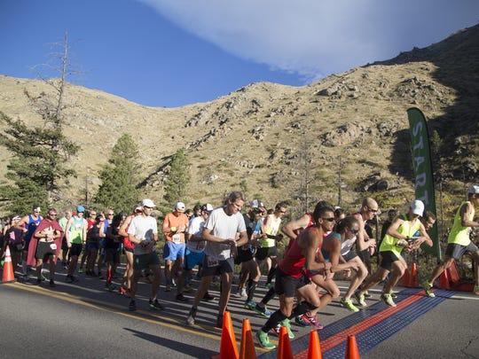 Runners cross the starting line of the Equinox Half-Marathon from Mishawaka down through the Poudre Canyon Sunday, September 18, 2016.