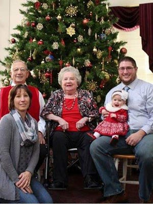 Ruthanna Dusman, center, poses for a holiday portrait with her son, Ralph Dusman, left; Ralph's daughter, Cheryl Dusman-Andrews, left; Cheryl's son Cody Andrews, right; and Cody's daughter, Nora Andrews, on dad's lap.