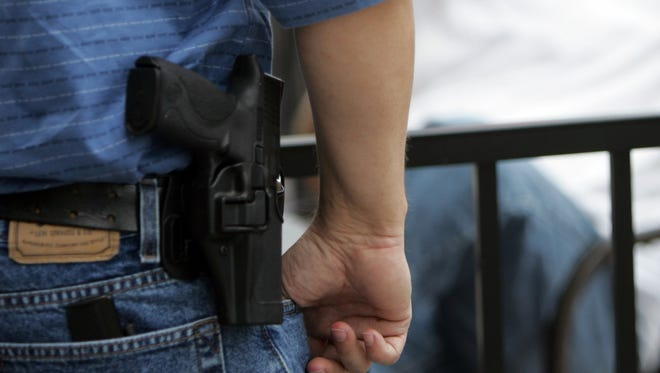 A Genesee County judge has ruled a father can openly carry his pistol inside his daughter's elementary school.