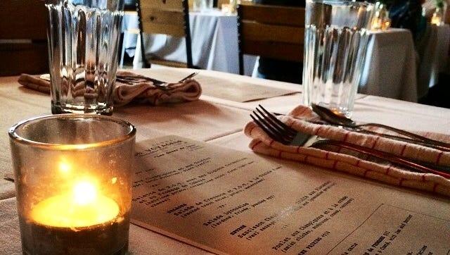 The table is set for Cure's Menu du Voyageur dinner series.