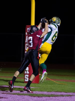 Horizon senior wide receiver Nick Lylyk catches a touchdown pass over Boulder Creek junior defensive back Travis Ward on Friday, Oct. 17, 2014, in Anthem.