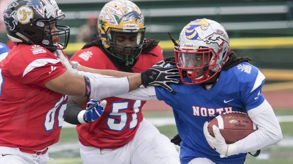 South Pointe wide receiver Steven Gilmore Jr., right, the North's offensive MVP, tries to get away from a pair of South defenders in the North's 24-12 win Saturday in the Touchstone Energy North-South all-star game at Doug Shaw Memorial Stadium in Myrtle Beach.