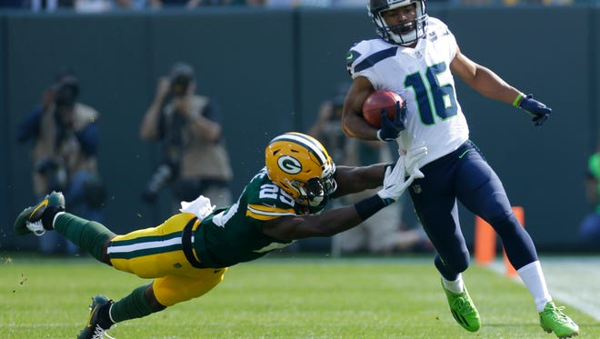 Seattle Seahawks wide receiver Tyler Lockett (16) is shoved out of bounds after a 43-yard kickoff return by Green Bay Packers defensive back Kentrell Brice (29) during the first quarter of their game Sunday, September 10, 2017 at Lambeau Field.
