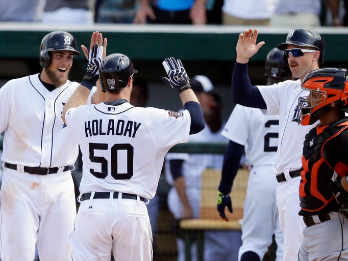 Detroit Tigers' Bryan Holaday (50) is congratulated