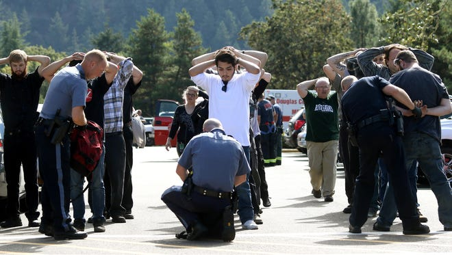 Associated Press Police search students outside Umpqua Community College in Roseburg, Oregon, on Thursday after a deadly shooting there. Police search students outside Umpqua Community College in Roseburg, Ore., on Thursday after a deadly shooting at the campus.