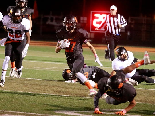 Aztec's Sebastian McNeal runs the ball against Gallup on Friday at Fred Cook Memorial Stadium in Aztec.