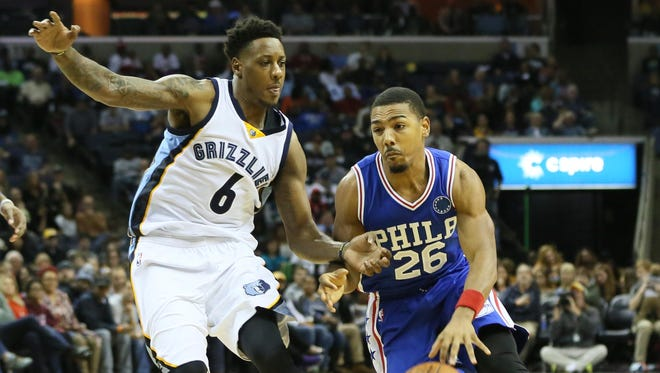 Nov 29, 2015; Memphis, TN: Philadelphia 76ers guard Phil Pressey (26) drives against Memphis Grizzlies guard Mario Chalmers (6) at FedExForum.
