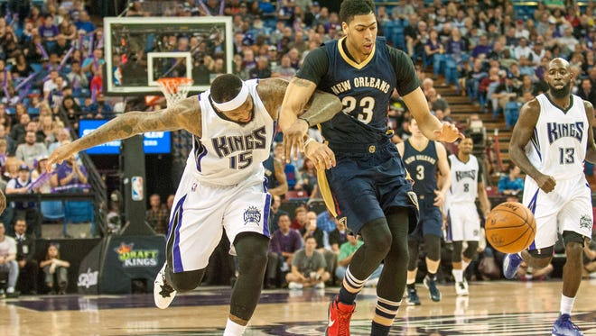 New Orleans Pelicans forward Anthony Davis (23) is fouled by Sacramento Kings center DeMarcus Cousins.