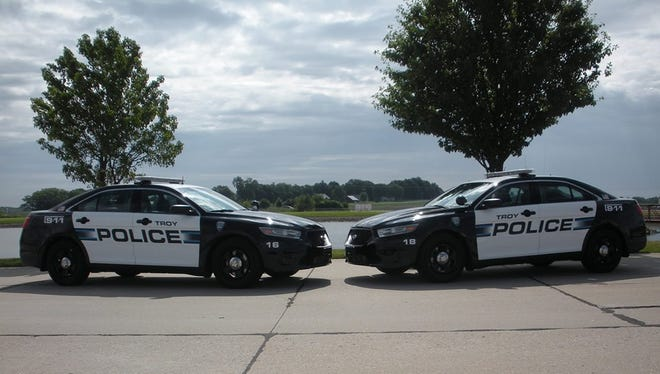 Troy Police Department patrol cars.