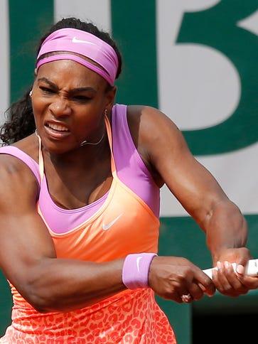 Serena Williams returns the ball to Germany's Anna-Lena