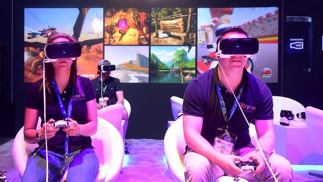 Gaming fans sample Samsung's Gear VR powered by Oculus Los Angeles Convention Center on June 16, 2016 in Los Angeles, California on the third day of the 2016 Electronic Entertainment Expo, or E3, the annual video game conference and show.