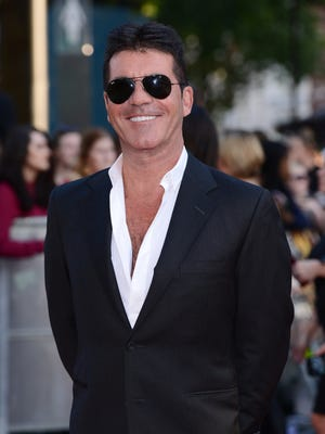 Check out that grin. Simon Cowell is going to be a dad!