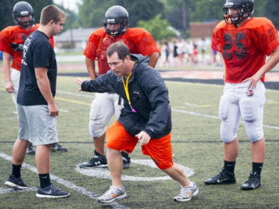 Coach Jeremy Jones works with his York Suburban football players during preseason practice in August. Tuesday night, the West York school board approved hiring Jones as the Bulldogs' head football coach. (File -- GameTimePA.com)
