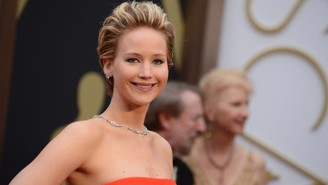 FILE - In this March 2, 2014 file photo, Jennifer Lawrence arrives at the Oscarsat the Dolby Theatre in Los Angeles.   As the celebrity photo-hacking scandal has made clear, privacy isn't what it used to be. Whether famous or seemingly anonymous, people from all walks of life put all sorts of things online or into cloud-based storage systems, from vital financial information to the occasional nude photo. Periodic cases of hacking fuel outrage, but there's no retreat from digital engagement or any imminent promise of guaranteed privacy. (Photo by Jordan Strauss/Invision/AP)