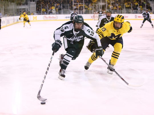 The Spartans secured a first-round bye in the Big Ten tournament thanks to Saturday's 2-1 win at Michigan's Yost Arena in Ann Arbor.
