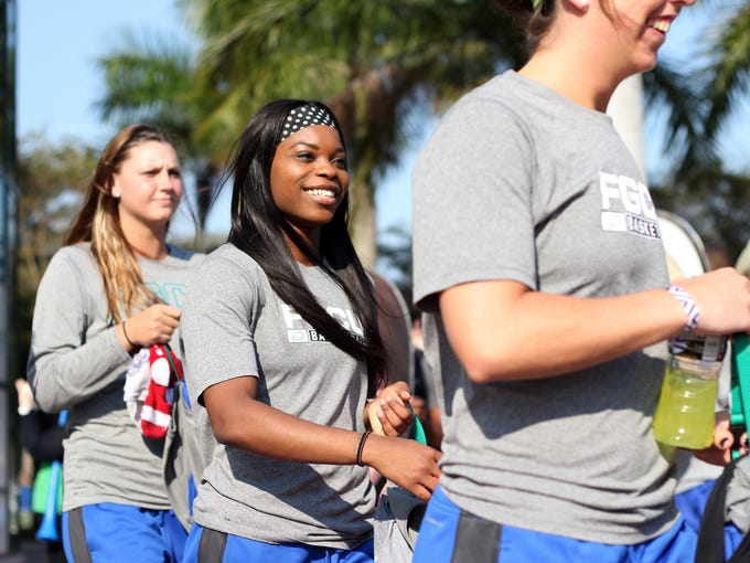 Kaniesha Atwater smiles as she walks to the bus with