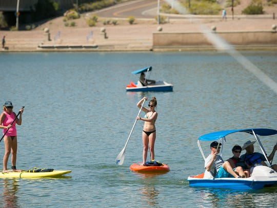 Patsy Hartman, left, and Sam Downie, 15, paddleboard