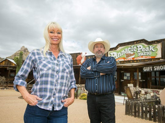 Sales and Events Director Lisa Cyr, left, and Manager Scott Browning outside Pinnacle Peak Patio in Scottsdale.