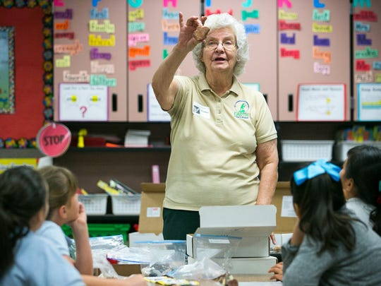 Mardy Zimmerman with the Earth Science Museum shows different types of Arizona rocks to students at Encanto Elementary in Phoenix on  May 7, 2015. Zimmerman was a volunteer for the Mining and Mineral Museum.