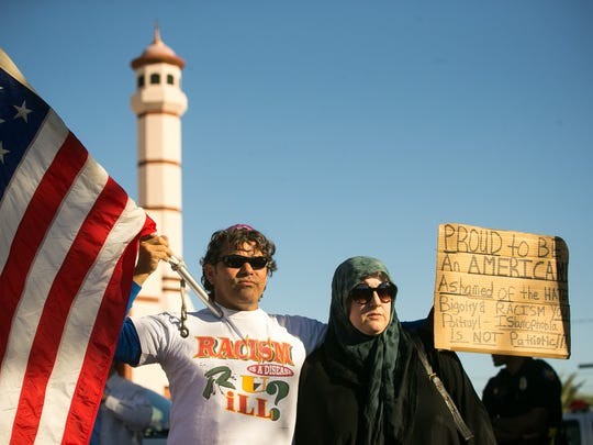 Charles Silver (left) and Lisa Hood protest for peace