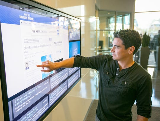 Pyxl employee Dereck Bermudez tries out a new touchscreen