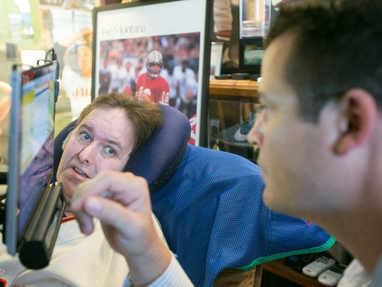 ALS patient Ron Hunting works with his speech therapist
