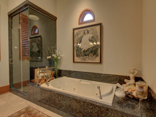 Luxurious bath is inviting with designer touches.