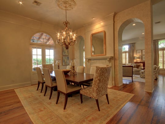 The dining room is large with access to the  living and outdoor spaces.