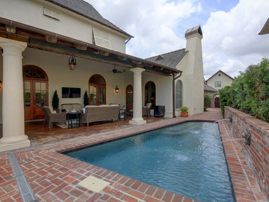An outdoor living area and pool are perfect for entertaining.