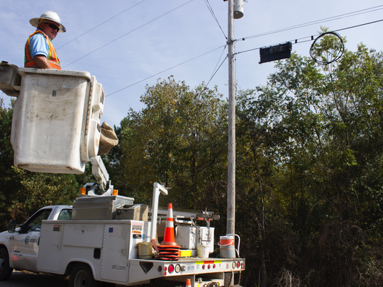 AT&T facility technician Chris Broyles takes a break from splicing fiber for cables providing Internet access to Panola County.