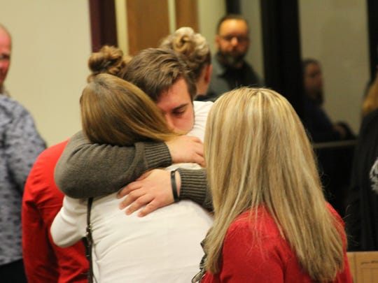 Family members of murder victim Rachelle Wood embrace after learning the victim's brother-in-law will serve 22.5-50 years in prison for murder.