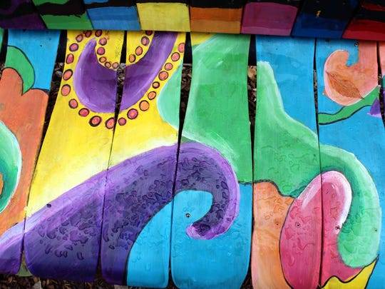 A close-up look at seat of the fanciful crayon buddy bench at Klem South Elementary in Webster.