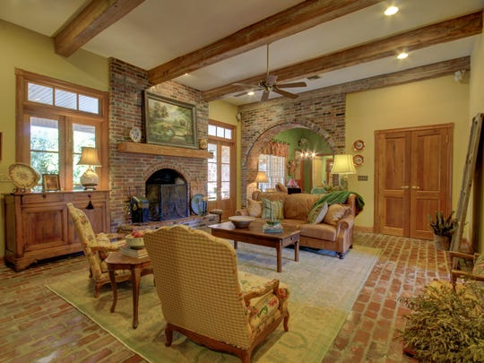 Antique brick floors run from the living to kitchen areas.