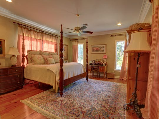 Antique wood floors add warmth to the master bedroom.