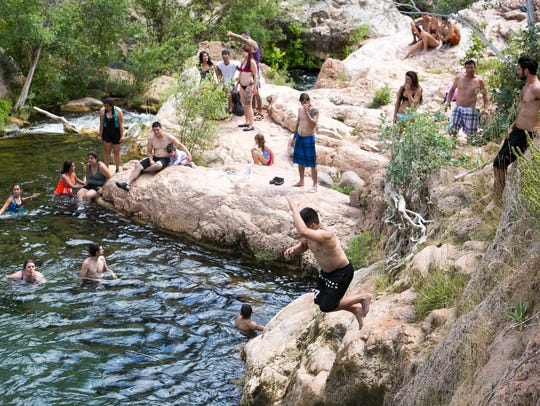 Hikers swim at Fossil Springs on Friday, June 12, 2015.