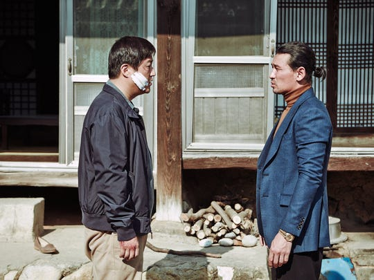 """Kwak Do-won (left) and Hwang Jung-Min in """"The Wailing."""""""