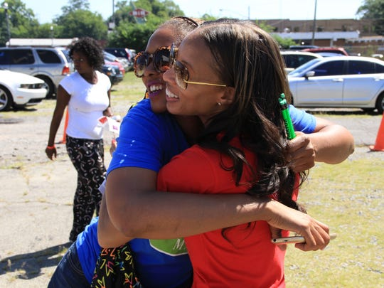 Dr. Stephaine Walker, right, hugs a participant at