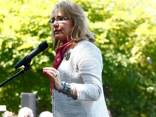 """When former Arizona U.S. Rep Gabrielle Giffords spoke at a gun-control rally during the Democratic National Convention in Philadelphia, she told the crowd, """"Stopping gun violence takes courage — the courage to do what's right, the courage of new ideas,"""" on July 26, 2016."""