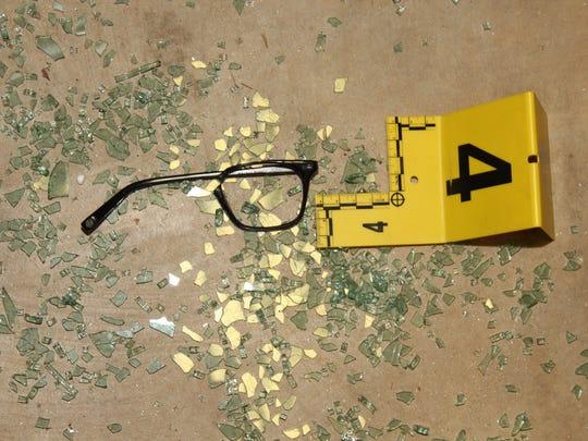 Dan Markel's shattered eye glasses sit on the floor