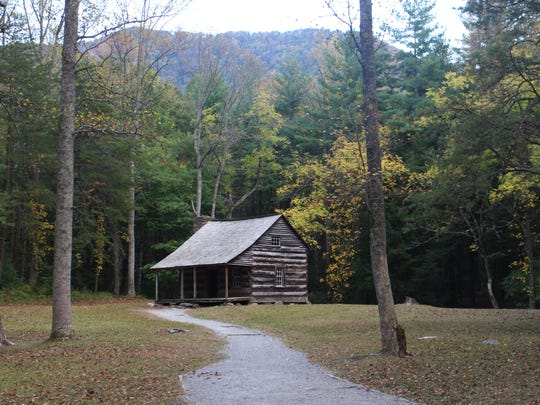 Yellow leaves accent the Carter-Shields Cabin in Cades