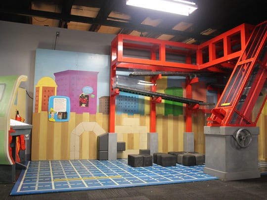 """The Construction Site at the """"Curious George: Let's Get Curious"""" exhibit at Impression 5 Science Center."""