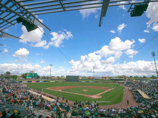 Fans fill Mesa's Hohokam Stadium to watch the Oakland