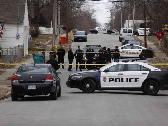 Springfield police at the scene of a homicide on South New Avenue in February.