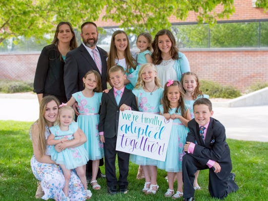 Connie and Ben Sowards pose for a photo with their 11 children. The Sowards adopted four of the children on Monday, April 17, 2017.