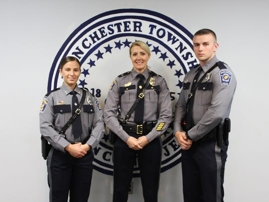 From left to right: Patrol officer Victoria Raub, police chief Lisa Parker and patrol officer Gavin Reilly. Raub and Reilly were sworn in May 1 as new patrol officers to the Manchester police department.