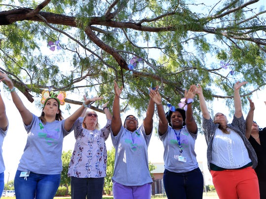 Employees of the Behavioral Health Center of Nueces County joined more than 60 other communities across Texas to focus attention on children's mental health by releasing paper butterflies at the facility on South Port Avenue on Thursday, May 4, 2017.
